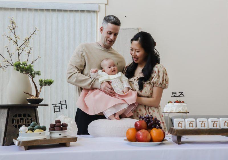 couple holding baby